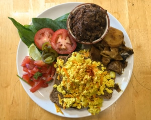 Tofu scramble on bread with potatoes, refried beans and salad.
