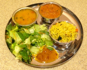 Curry with rice, salad and dhal.