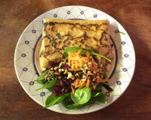 Jerk tofu galette with side salad.