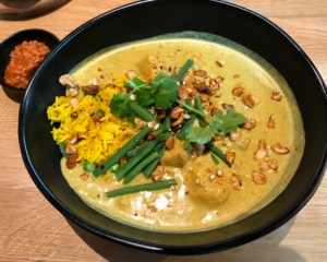 Sweet potato and green bean curry with rice and chili sauce.