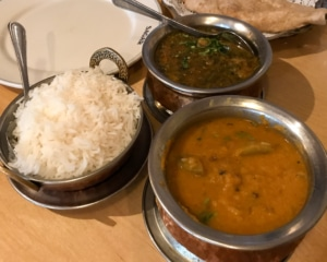 Assorted dishes of curries and rice.